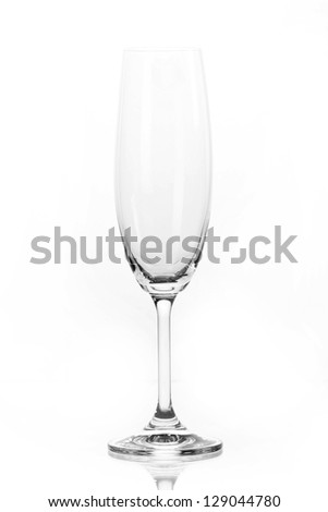 Single empty wine glass. Isolated on a white background. Black and white image. - stock photo