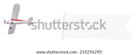 Single engine plane flying with blank banner isolated on a white background - stock photo