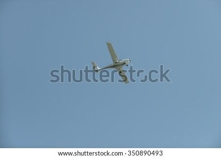 Single engine private lightweight aircraft in the blue sky