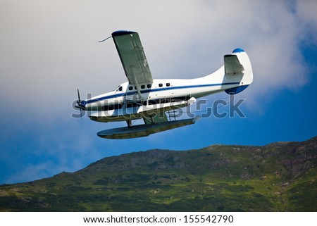 Single engined seaplane coming in to land in Alaska - stock photo