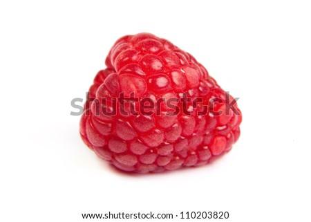 Single fresh sweet raspberry. Isolated over white background. Close up macro shot. Image was professionally retouched - stock photo