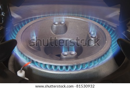 single gas hob in closeup burning blue flames - stock photo