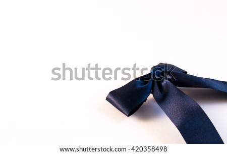 single gift bow, blue satin,  white background