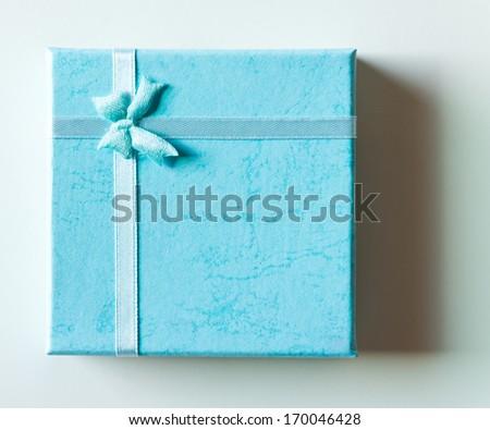 Single gift box on the floor. - stock photo