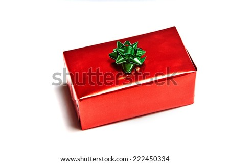 Single gift box with bow on white background - stock photo