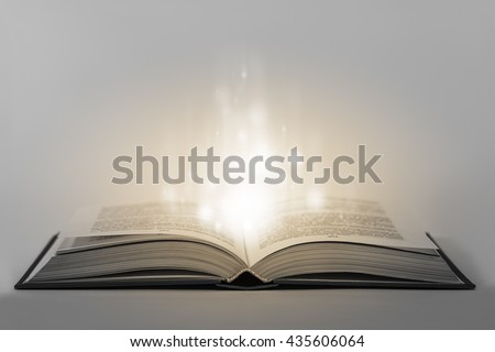 Single glowing unreal old magical book with enegry inside. Conceptual image