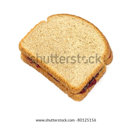Single grape jelly sandwich with wheat bread on a white background.