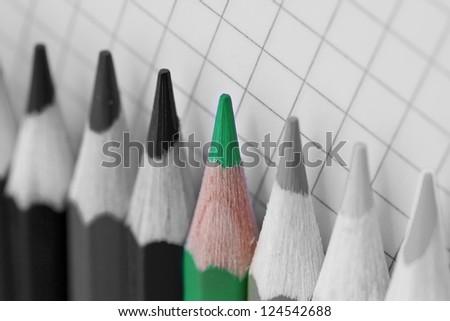 single green pencil in selective coloured image - stock photo