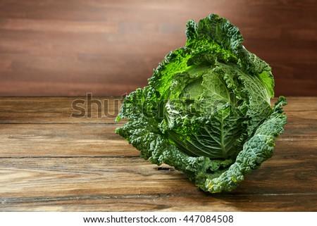 Single head of Savoy cabbage - stock photo