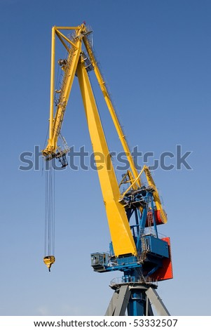 Single huge crane with blue sky at the background