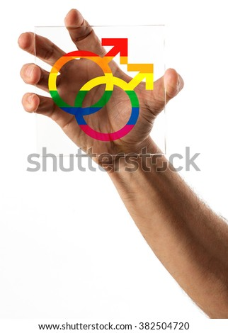 Single human hand gripping a square piece of glass with gay marriage symbols in the middle on isolated background