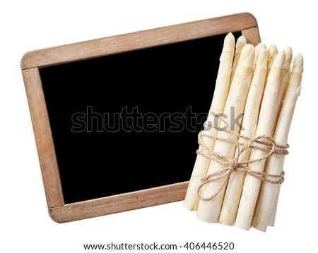 Single isolated bundle of raw white asparagus tied tightly with brown rope in front of blank chalkboard with copy space over isolated background - stock photo