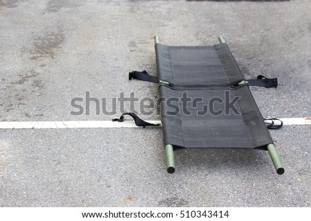 single light portable stretcher for medical evacuation or medevac for law enforcement tactical team isolated on road