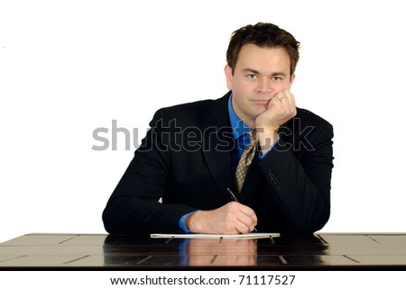 Single man in  business attire sitting at a table working