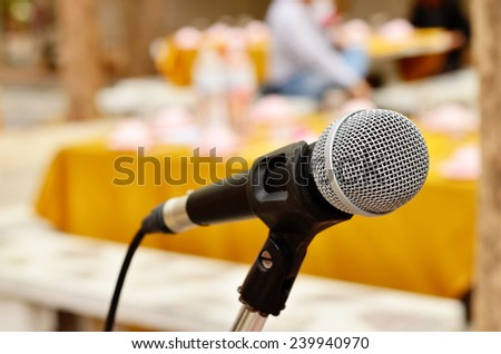 Single Microphone in the blur background in the conference  room for seminar