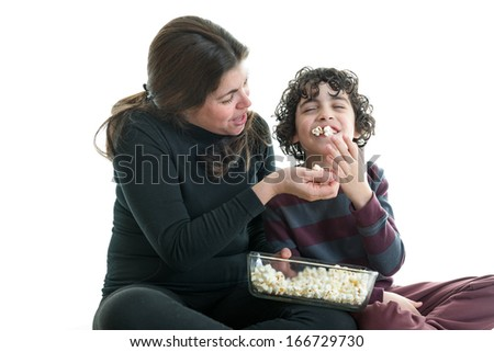 Single mother and son eating popcorn. White background - stock photo