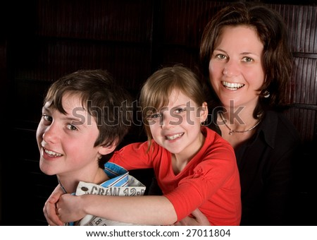 Single mother posing with her two teenager kids
