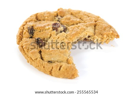 single oatmeal raisin cookie with bite taken out - stock photo