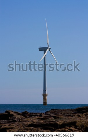 Single offshore wind turbine part of a larger wind farm at cambois beach blyth, northumberland. - stock photo