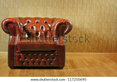 Single Old Antique Armchair Near The Wall - stock photo