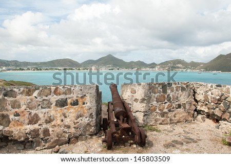Single Old Dutch Cannon points across Great Bay on the Island of Sint Maarten in the Caribbean