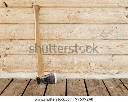 single old hatchet near the wooden wall - stock photo