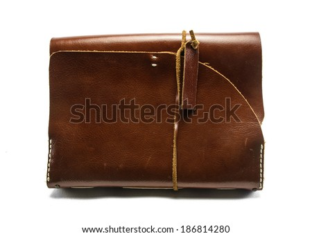 single old leather notebook isolated on the white background - stock photo