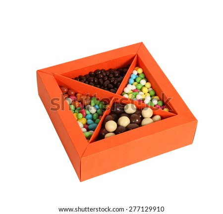 Single orange box full with candy on white background, cut out - stock photo