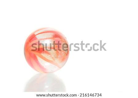 Single orange crystal marble isolated on white - stock photo