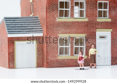 Single parent family concept with model people and house on white background - stock photo