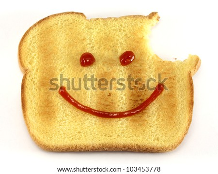 Single piece of toasted bread with a bite and drawn happy face isolated on white background. - stock photo