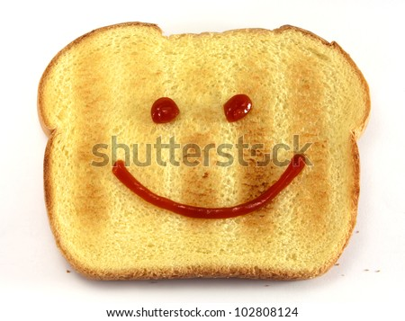 Single piece of toasted bread with a drawn happy face isolated on white background. - stock photo