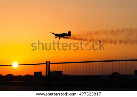 Single plane performing during an air show at sunset