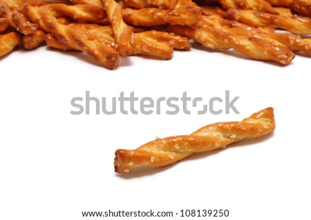 Single Pretzel with Many Pretzels in the Background - stock photo