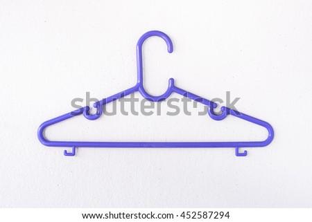 Single purple hanger clothe. - stock photo