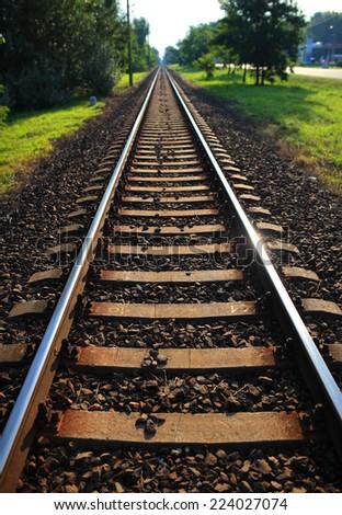 Single railway line in vertical - stock photo