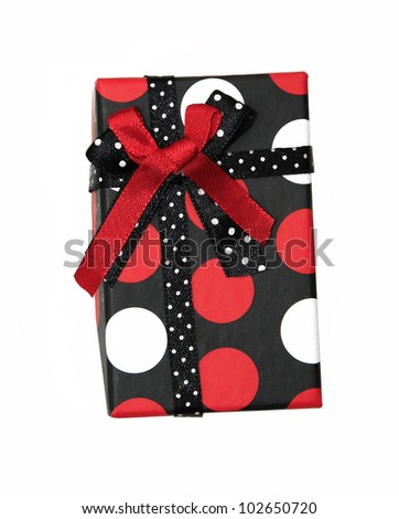 Single red and black ribbon gift bow box with polka dots isolated on white background - stock photo