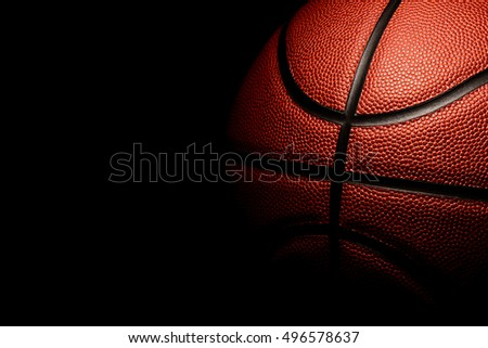 Single red Basketball on a black background