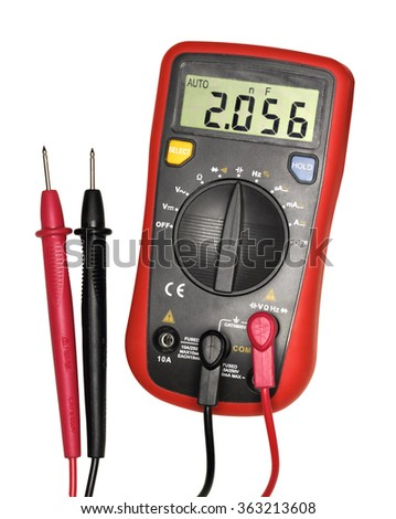 Single red-black digital multimeter. Isolated on white background. Close-up. Studio photography.