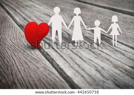 Single red heart shape on rustic wood panel with family paper character, abstract background in love in family, father, mather, son, daughter concept. Retro and vintage style. - stock photo