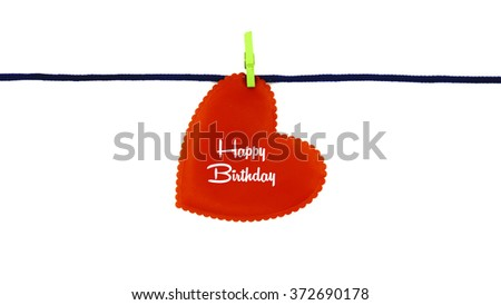 Single red love shape with text HAPPY BIRTHDAY clipped on blue rope isolated on white background - stock photo