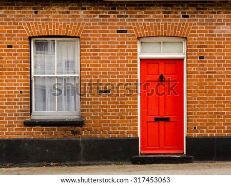 Single Red Painted Wooden Residential Front Door Set In A Traditional  Brickwork Exterior With A Window