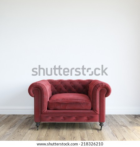 Single Red Velvet Armchair In Minimalist Interior Room - stock photo