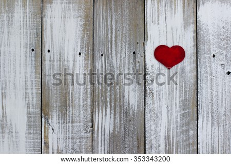 Single red wood heart hanging on antique rustic whitewash wooden background - stock photo