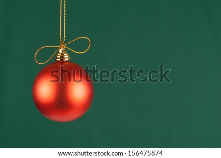 single red xmas ball hanged on green background - stock photo