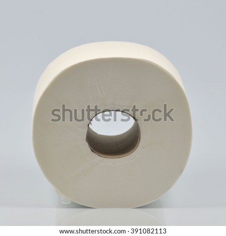 Single roll of toilet paper on neutral background