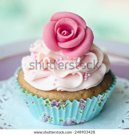 Single rose cupcake - stock photo