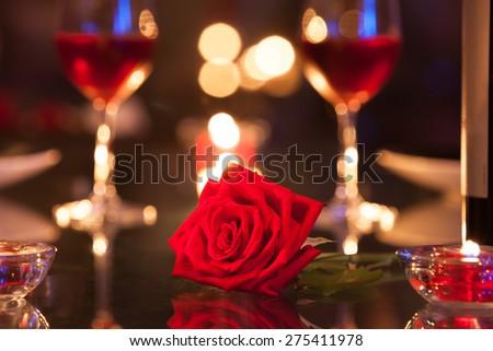 Single rose in a romantic setting.  - stock photo