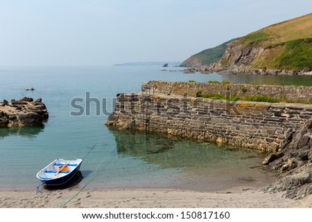 Single rowing boat in small harbour - stock photo