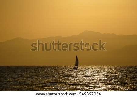 Single Sailboat at Sunset
